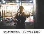 bearded male boxer training... | Shutterstock . vector #1079811389