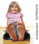Little Girl Sitting On A Woode...
