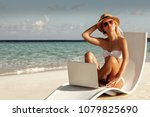 happy girl on the beach with a... | Shutterstock . vector #1079825690