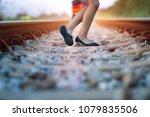 legs of a girl running hurry... | Shutterstock . vector #1079835506