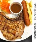 fried pork chop with slice... | Shutterstock . vector #1079841068