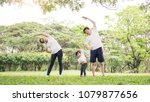 family exercising and jogging... | Shutterstock . vector #1079877656