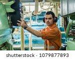 marine engineer inspecting ship'... | Shutterstock . vector #1079877893