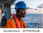 tired seaman ab or bosun on... | Shutterstock . vector #1079878238