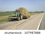 Tractor Pulling Hay Down...
