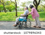 senior couple in park and in... | Shutterstock . vector #1079896343
