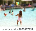 girl plays with a ball in a... | Shutterstock . vector #1079897159