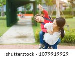 the son rode behind his mother... | Shutterstock . vector #1079919929
