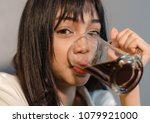 asian young woman drinks coffee ... | Shutterstock . vector #1079921000