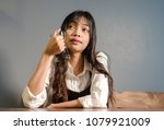 asian young woman drinks coffee ... | Shutterstock . vector #1079921009