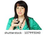 Dark-haired woman holding a glass of wine - stock photo