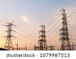 silhouette high voltage post on ... | Shutterstock . vector #1079987513