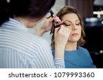 female make up artist working... | Shutterstock . vector #1079993360