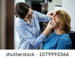 female make up artist working... | Shutterstock . vector #1079993366