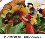 Small photo of Mixed salad with fired fish and Olives Slice Kalamata Riviana