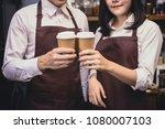 closeup hand barista holding... | Shutterstock . vector #1080007103