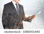european businessman using... | Shutterstock . vector #1080051440