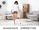 young woman with crutch and...   Shutterstock . vector #1080067148