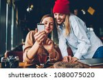 cheerful two hipsters watching... | Shutterstock . vector #1080075020