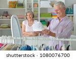 senior couple choosing hat  | Shutterstock . vector #1080076700