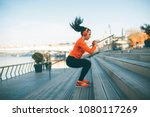 Fitness woman jumping outdoor...