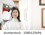hairdresser and asian women | Shutterstock . vector #1080125696