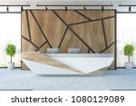Stock photo futuristic reception desk with two computers in an office interior with wooden geometric pattern 1080129089