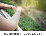 women resting at the balcony to ... | Shutterstock . vector #1080137264
