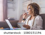 beautiful woman think and write ... | Shutterstock . vector #1080151196