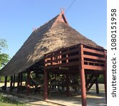 Small photo of Huay (traditional house) Tai Dam is characterized by a curved roof turtle shell. Cover the grass Almost reaching the ground instead of the lid. To protect the wind