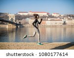 pretty young female athlete... | Shutterstock . vector #1080177614