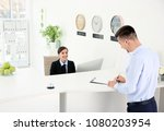 young man filling form at... | Shutterstock . vector #1080203954