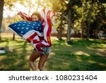 young patriotic woman with...   Shutterstock . vector #1080231404