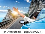 young woman is driving by car... | Shutterstock . vector #1080339224