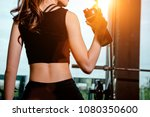asian woman exercising in the... | Shutterstock . vector #1080350600