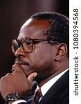 Small photo of Washington DC., USA, September 10, 1991 Clarence Thomas nominee for Associate Justice of the United States Supreme Court ponders questions to him from members of the Senate Judiciary Committee