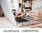 man holding credit card and... | Shutterstock . vector #1080395930
