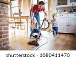 father and two toddlers doing... | Shutterstock . vector #1080411470