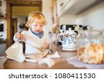 toddler boy in dangerous... | Shutterstock . vector #1080411530