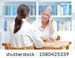 female doctor with her senior...   Shutterstock . vector #1080425339