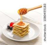 crackers with honey and fruit ... | Shutterstock . vector #1080455183