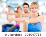 Group Of People Exercising At...