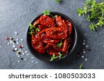 sun dried tomatoes with fresh... | Shutterstock . vector #1080503033