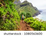hiker on the trail in green... | Shutterstock . vector #1080563600