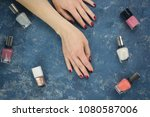 female hands with red polished... | Shutterstock . vector #1080587006