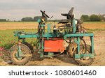 Small photo of a machine in the bulb fields macro to deflower the tulips in spring in Holland