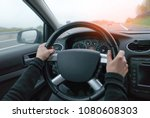 young woman driving in modern... | Shutterstock . vector #1080608303