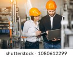 man and woman at a factory | Shutterstock . vector #1080612299