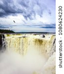 over the rumbling waterfall...   Shutterstock . vector #1080624230
