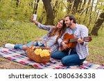 happy young couple enjoying... | Shutterstock . vector #1080636338